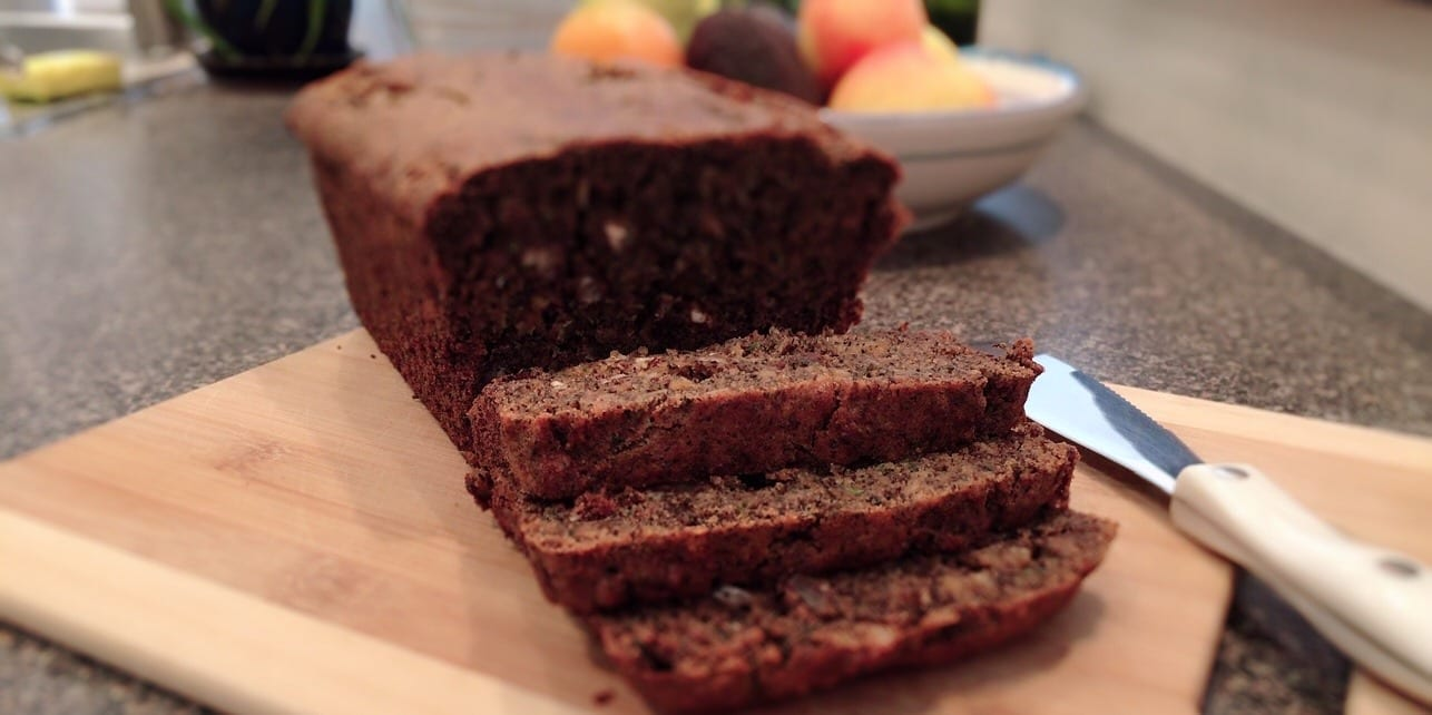 Gluten-Free Vegan Zucchini Apple Bread sliced on cutting board